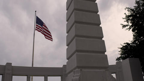 United States' flag blowing in the wind at Dealey Plaza, Dallas. Cloudy sky Footage