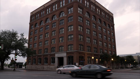 Tilting down shot of the Texas School Book Depository at Dealey Plaza, Dallas Footage
