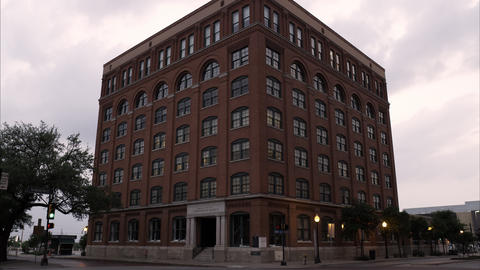 Tilting up shot of the Texas School Book Depository at Dealey Plaza, Dallas Footage