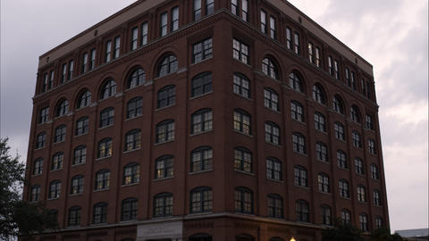 Tilting down shot of the Texas School Book Depository at Dealey Plaza, Dallas, T Footage