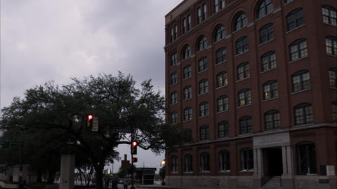 Panning left shot of the Texas School Book Depository at Dealey Plaza, Dallas, T Footage