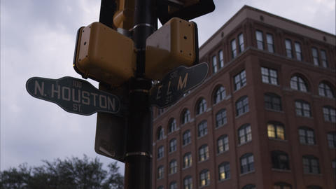 Cross street sign N. Houston St. and Elm St. with the Texas School Book Deposito Footage