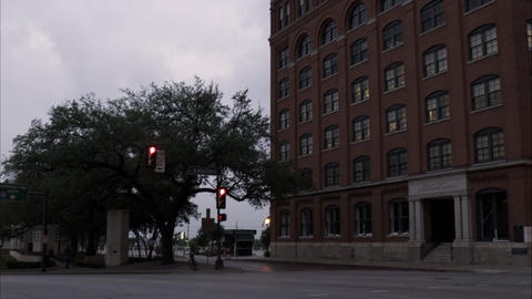 Panning shot from the street to the Texas School Book Depository at Dealey Plaza Footage