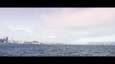 Panning shot from the Bay to San Francisco and the Golden Gate Bridge Footage