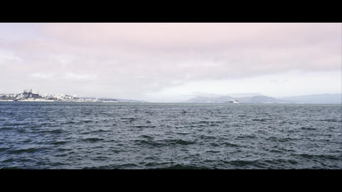 Panning shot from the Bay to San Francisco and the Golden Gate Bridge from just  Footage