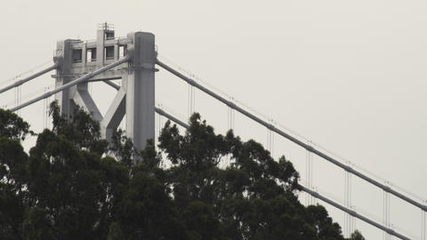Tight static shot of the top support structure of the Oakland Bay Bridge and som Footage
