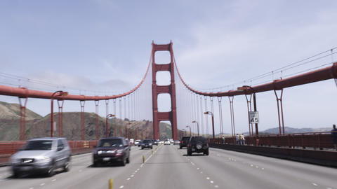 Point of view shot driving the Golden Gate Bridge on a sunny day Footage
