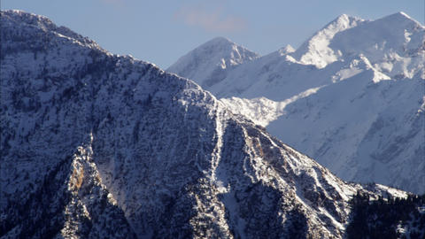 Panning shot of snow cover mountains in the Wasatch range, Utah Footage