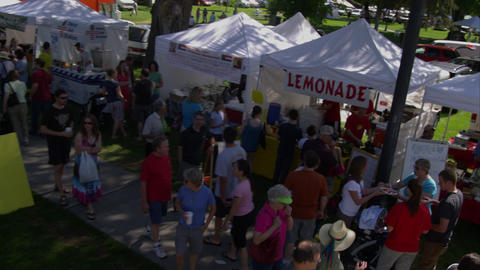 Crane shot of people at a farmers market Footage