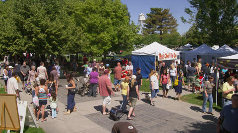 Crane in shot of people at a farmers market Footage