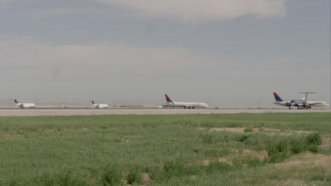 Airport runway with several planes, one taking off. Salt Lake Airport Footage