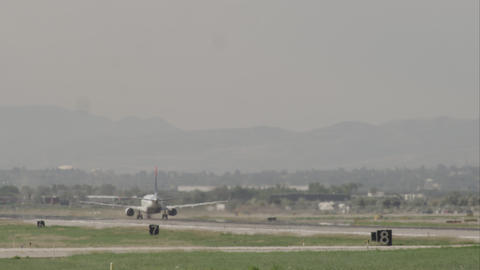 Following shot of an airplane taking off at the Salt Lake Airport Footage