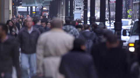 Chicago pedestrians downtown. Faces blurred Footage