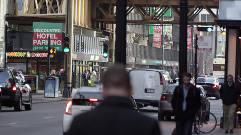 Chicago pedestrians and traffic downtown. Faces blurred Footage