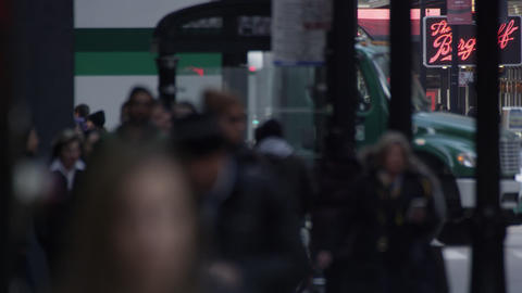 Tight shot of pedestrians and background traffic in downtown Chicago. Faces blur Footage