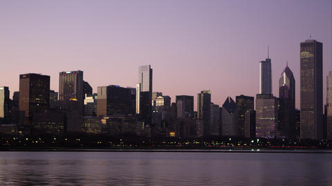 Panning shot of the Chicago cityscape over the water Footage