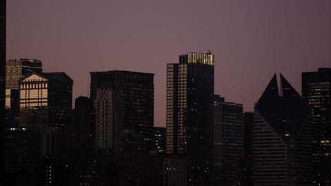 Tight panning shot of buildings in Chicago at sunset Footage