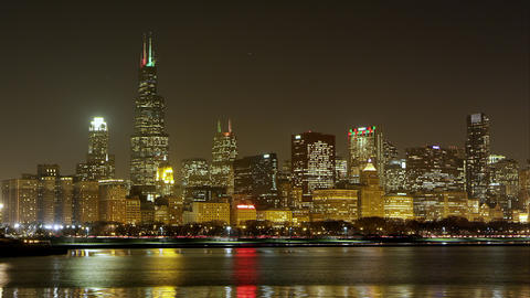 Night timelapse of Chicago. Airplanes visible Footage