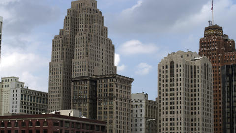Tight panning left shot of the high rise buildings in Detroit Footage