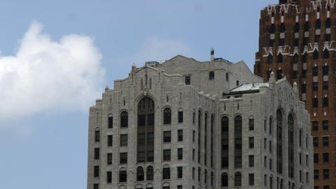 Tight panning shot of skyscraper skyline of Detroit Footage