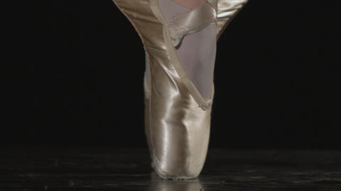 Tight shot of ballerina feet moving from flat foot positions to on point Live Action