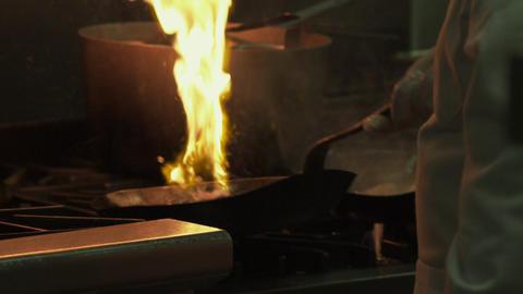 Restaurant saute pans catching fire Live Action