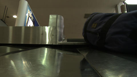Camera on the baggage claim conveyor Live Action
