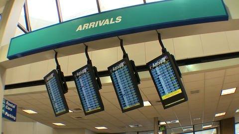Shot of the Arrivals screens in an airport Live Action
