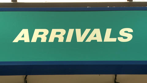 Tight shot of an arrival sign in an airport Live Action