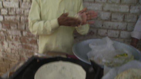 Man Frying Chapati Footage