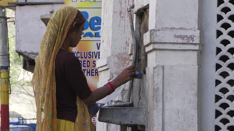 Women filling up bottle of water Footage