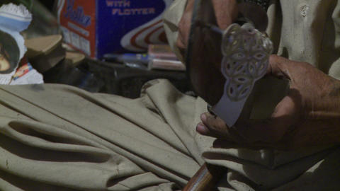 Close up view of hands working on sandals Footage