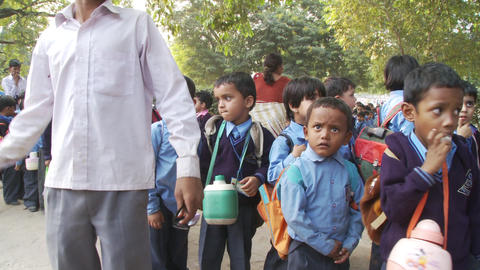 School children standing in line with back packs Footage