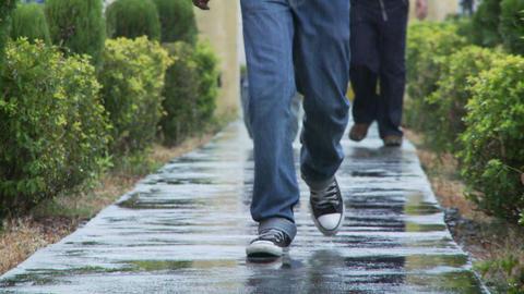 Walking towards camera on sidewalk Footage