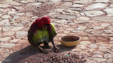 woman breaking up dirt clods Footage