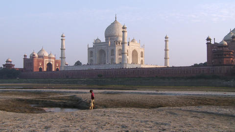 Two boys playing in the water with the Taj Mahal in the background Footage