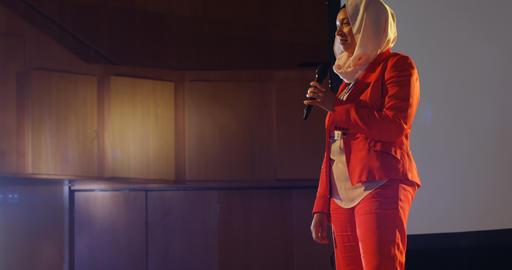 Businesswoman speaking on stage in auditorium 4k Live Action