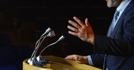 Caucasian businessman speaking at podium on stage in auditorium 4k Live Action