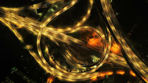 Time lapse of aerial view of highway junctions. Bridge roads shape circle in structure of Footage
