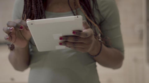 Close up view of african american woman hands holding white tablet gadget Live Action