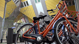 Netherlands South Holland Rotterdam orange bicycle in front of Cube House GIF