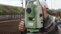 Surveyor using digital level optical equipment Footage