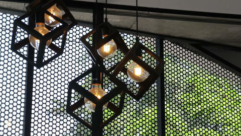 Design hanging light bulbs in coffee shop Footage
