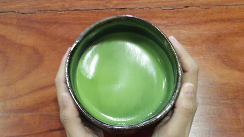 Bowl of hot matcha green tea drinking Footage