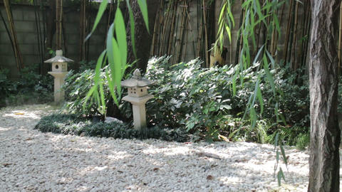 Small japanese rock garden with stone lantern Stock Video Footage