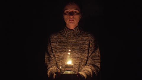 Sad Woman With Lantern Looking Into The Camera Footage