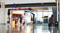 Dulles Duty free Americas shop store with people slow motion in airport Footage