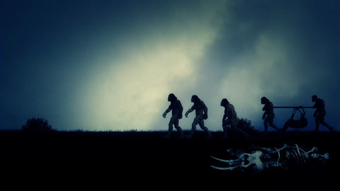 Group of Cavemen Returning From Hunting with Dead Deer Live Action