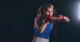A beautiful woman conducts a shadow fight practicing technique and speed of Footage