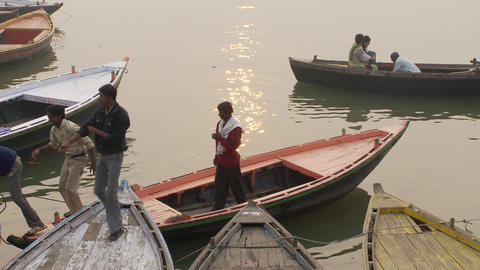 Several men getting off their boat in India Footage